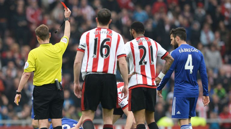 Chelsea's John Terry is shown a red card by referee Mike Jones after fouling Sunderland's Wahbi Khazri