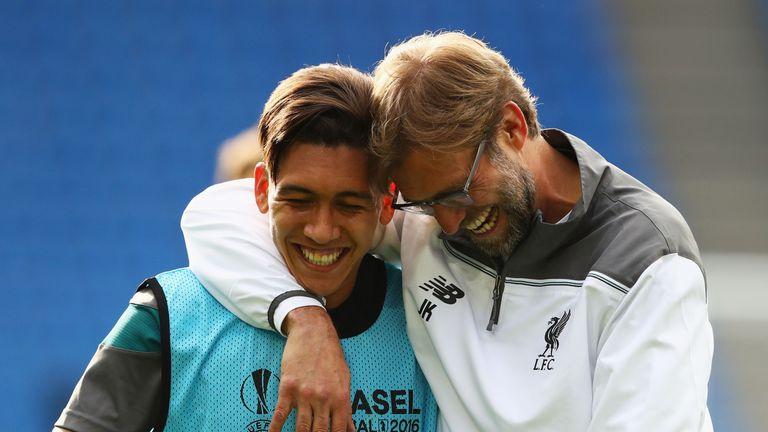 Firmino laughs with Liverpool manager Jurgen Klopp