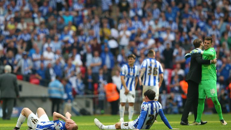 Dejected Sheffield Wednesday players are left on the pitch after the Sky Bet Championship Play Off Final match between Hull City