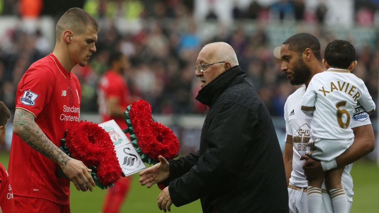 Martin Skrtel (left) presents a wreath in commemoration of the 96 Hillsborough victims to Brian Devonside