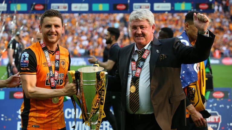 Alex Bruce and Steve Bruce celebrate Hull's play-off success
