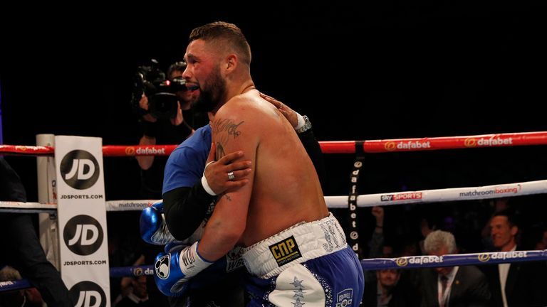 Trainer Dave Coldwell embraces the victorious Bellew
