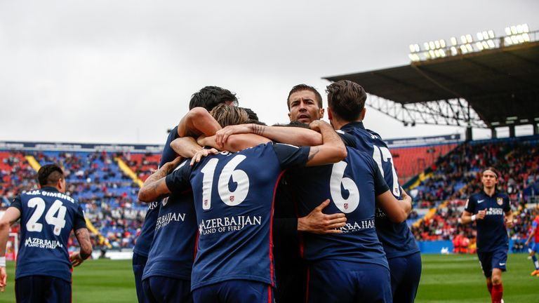 Atletico's players celebrate after Fernando Torres' early goal against Levante