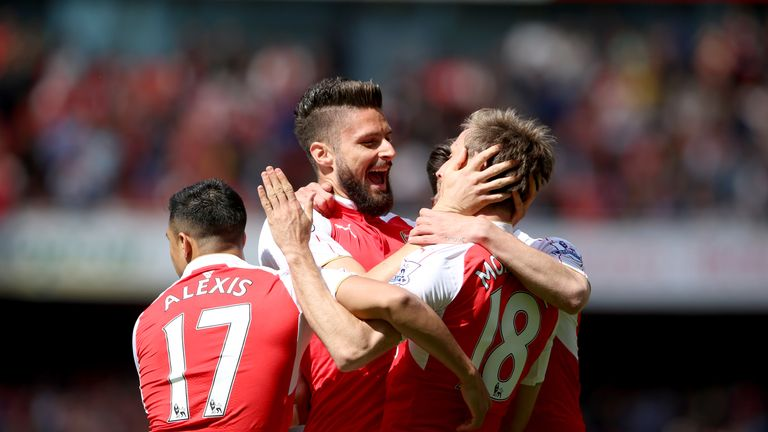 Arsenal's Olivier Giroud (centre) celebrates scoring their first goal of the game with team-mates v Aston Villa, Premier League