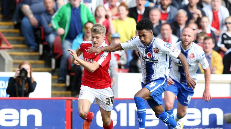 Wallsal's Rico Henry (right) and Barnsley's Lloyd Isgrove battle for the ball during the Sky Bet League One playoff, first leg match at Oakwell, Barnsley