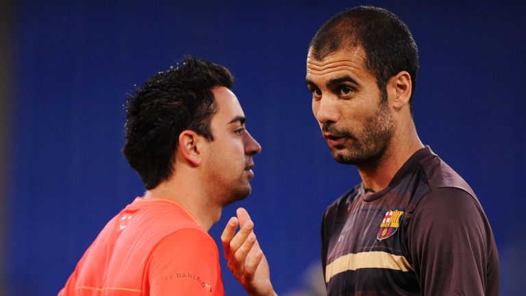 Pep Guardiola, during his time as coach of Barcelona, speaks to Xavi during a training session