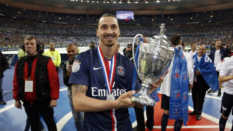 Paris-Saint-Germains Swedish forward Zlatan Ibrahimovic holds up the trophy after winning the French Cup final football match against Auxerre at the Stade