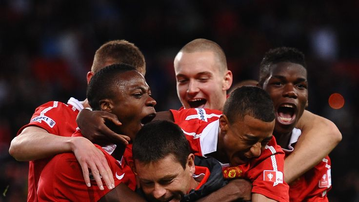Paul McGuinness is mobbed by the likes of Jesse Lingard and Paul Pogba following Manchester United's FA Youth Cup Final win over Sheffield United in 2011