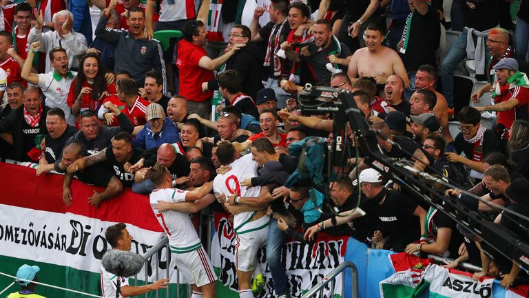 Adam Szalai (C) of Hungary celebrates scoring his team's first goal v Austria with his team-mate Balazs Dzsudzsak and supporters, Euro 2016, Bordeaux