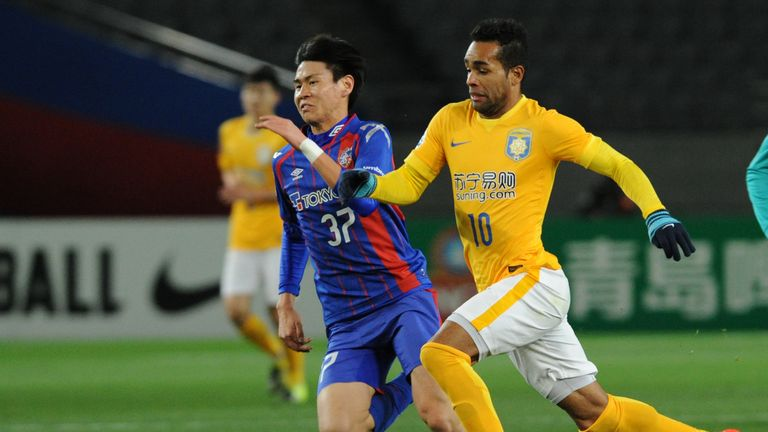 Alex Teixeira (right) signed for Jiangsu Suning after opting against moving to Liverpool