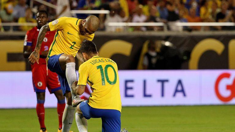 Lucas Lima of Brazil celebrates his goal with Dani Alves