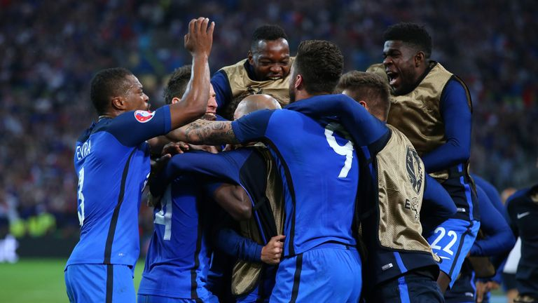 The France squad celebrate with Antoine Griezmann after he scored his sides first goal against Albania