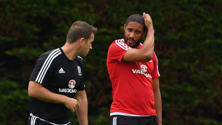 Wales captain Ashley Williams chats with Dr Adam Owen during training at their Euro 2016 base camp in Dinard