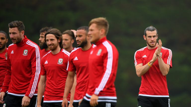Bale applauds the local children during an open Euro 2016 Wales training session