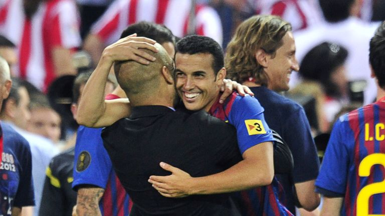Pep Guardiola hugs Pedro during their days with Barcelona