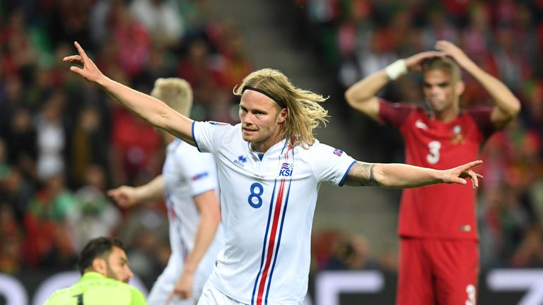 Iceland's midfielder Birkir Bjarnason celebrates the team's first goal