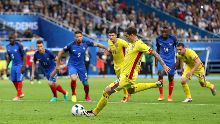 Romania's Bogdan Stancu scores his side's first goal from the penalty spot
