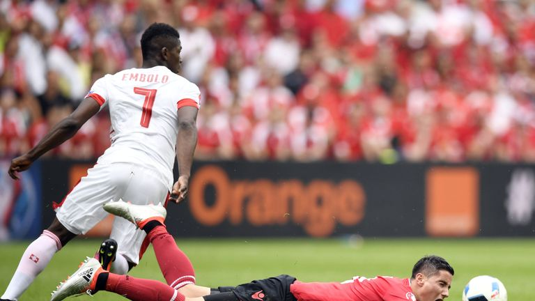 Albania's midfielder Odise Roshi (bottom) is challenged by Switzerland's forward Breel Embolo during the Euro 2016 group A football match between Albania a