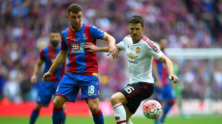 James McArthur of Crystal Palace and Michael Carrick of Manchester United battle for the ball during The Emirates FA Cup Final