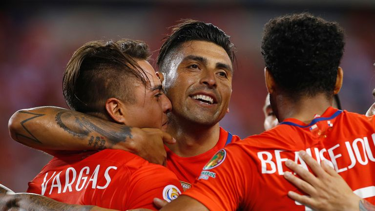 Eduardo Vargas #11 of Chile is congratulated by teammates Gonzalo Jara #18 and Jean Beausejour #15 after scoring second goal of