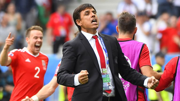 Wales' coach Chris Coleman (R) reacts afters Wales scored the opening goal during the Euro 2016 group B football match between Wales and Slovakia at the St