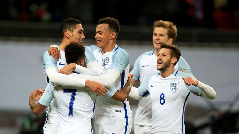 England's Chris Smalling (left) celebrates scoring his side's winning goal