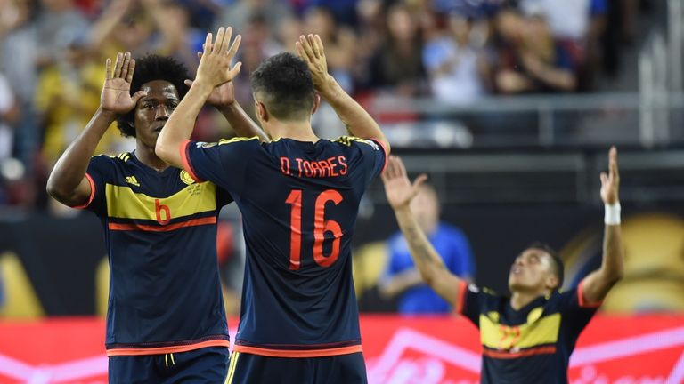 Colombia's players celebrate after defeating the USA during the Copa America Centenario football tournament match in Santa Clara, California, United States