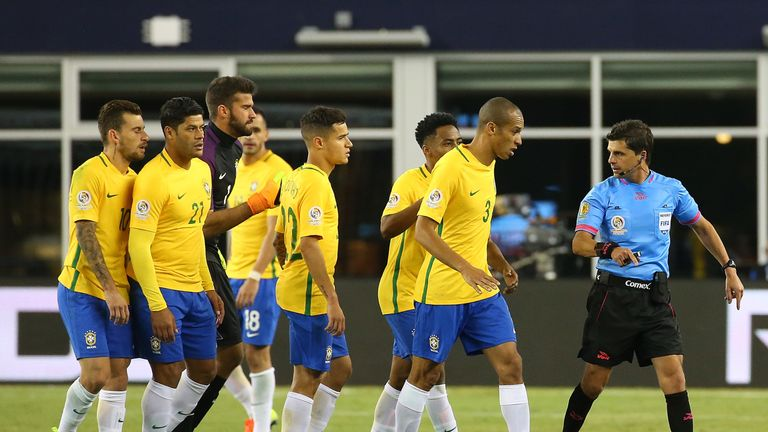 Miranda leads Brazilian protests after the goal which knocked them out of the Copa America