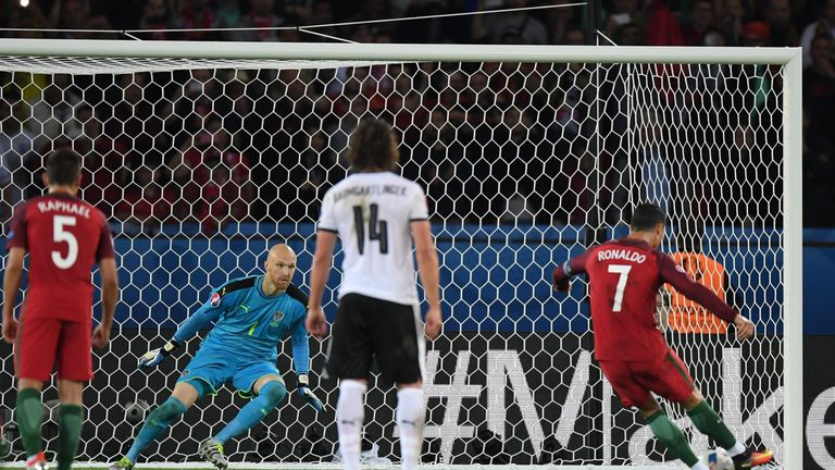 PARIS, FRANCE - JUNE 18: Robert Almer of Austria attempts to save as Cristiano Ronaldo of Portugal hits the post from the penalty spot during the UEFA EURO