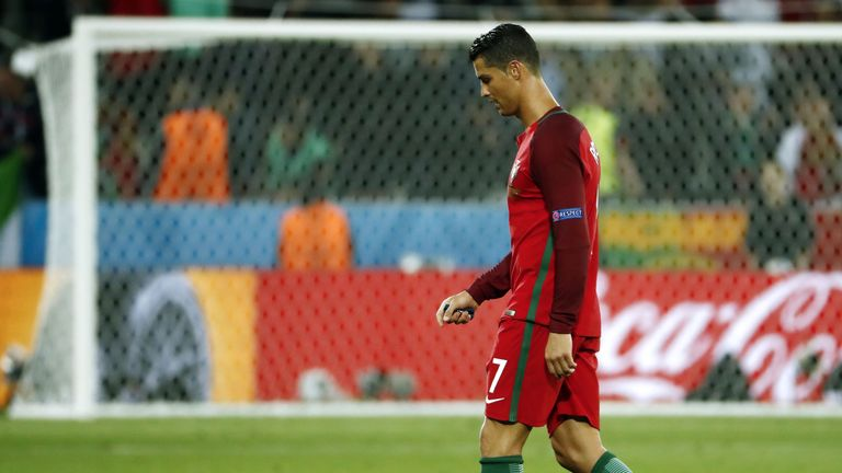 Portugal's forward Cristiano Ronaldo walks over the pitch at the end of the Euro 2016 group F football match between Portugal and Iceland