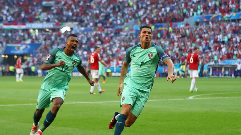 Cristiano Ronaldo (R) of Portugal  celebrates scoring his team's second goal against Hungary with his team-mate Nani (L)