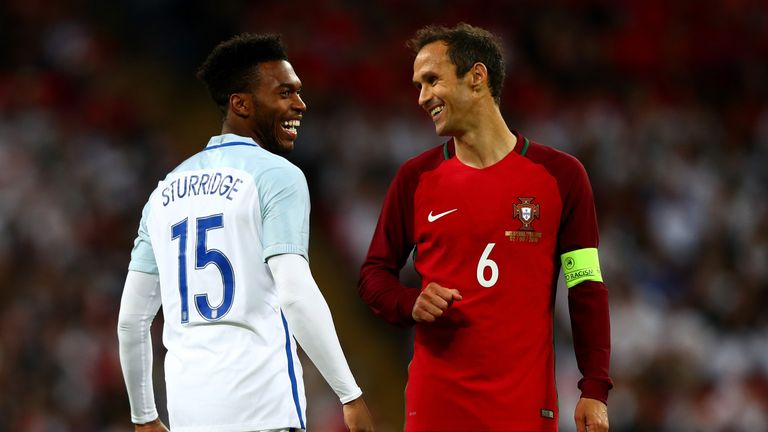 LONDON, ENGLAND - JUNE 02:  Daniel Sturridge of England and Ricardo Carvalho of Portugal smile during the international friendly match between England and