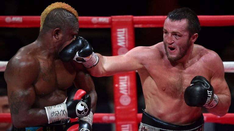 Russia's boxer Denis Lebedev (R) vies France's boxer Youri Kayembre Kalenga during their WBA Cruiserweight title fight in Moscow late on April 10, 2015. AF