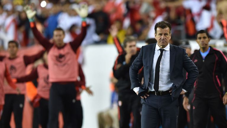 Brazil's coach Dunga (R) is pictured after being defeated by Peru