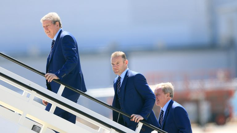 England manager Roy Hodgson, captain Wayne Rooney and assistant manager Ray Lewington board the plane at Luton Airport.