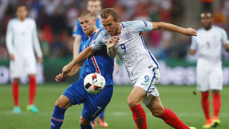 Harry Kane of England and Johann Gudmundsson of Iceland compete for the ball during the UEFA EURO 2016 round of 16 match between En