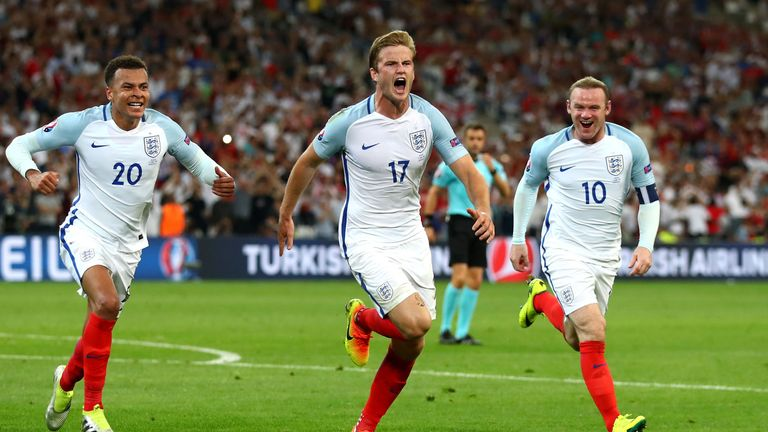 Eric Dier (C) of England celebrates scoring his team's first goal with his team mates during the UEFA EURO 2016 Group B match