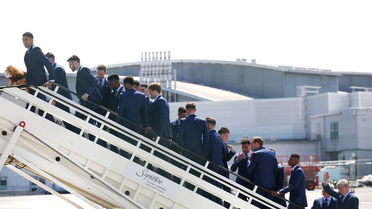 England manager Roy Hodgson (right) waves as the team board the plane at Luton Airport.