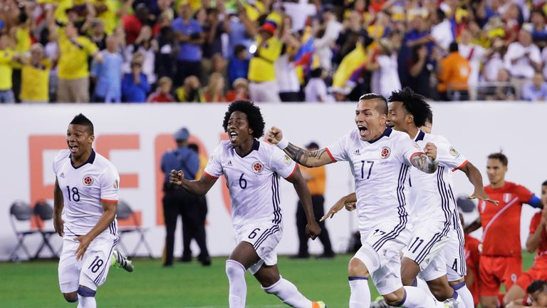 Colombia celebrate their overtime shootout  win against Peru during the Quarterfinal match of Copa America