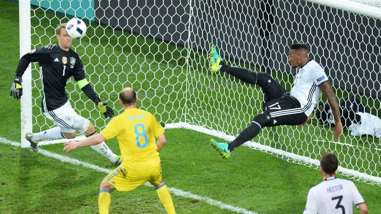 Germany's defender Jerome Boateng (2ndR) kicks the ball from his goal line during the Euro 2016 against Ukraine