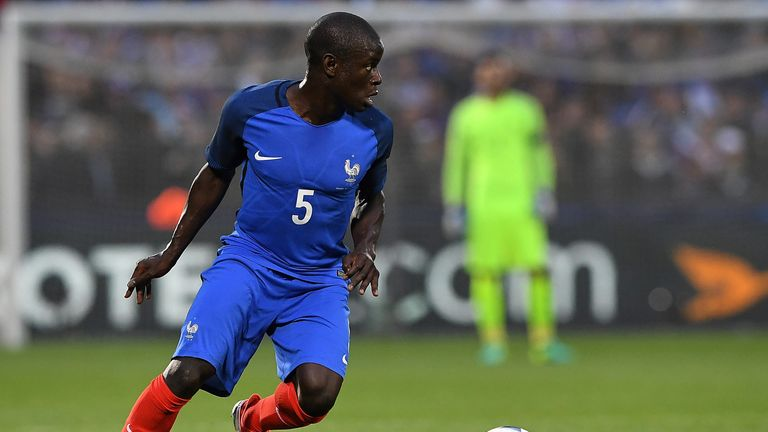 France's midfielder N'Golo Kante drives the ball during the friendly football match between France and Scotland, at the St Symphorien Stadium in Longeville