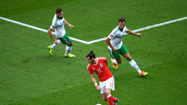 Stuart Dallas and Jonny Evans keep a close eye on Gareth Bale