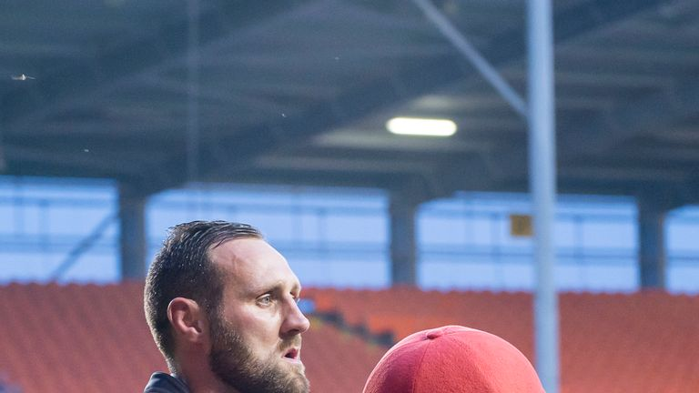 Leigh's Gareth Hock with the Centurions mascot