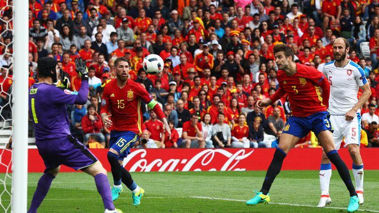 Gerard Pique heads the ball to score Spain's winner past Petr Cech as the Czech Republic are beaten
