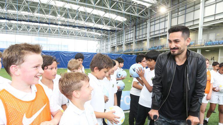 Manchester City's Ilkay Gundogan visits CITC children