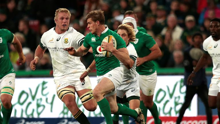 Andrew Trimble makes a break in the narrow defeat for Ireland