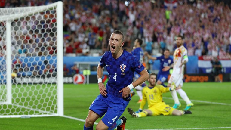 Ivan Perisic wheels away in celebration after scoring the winner