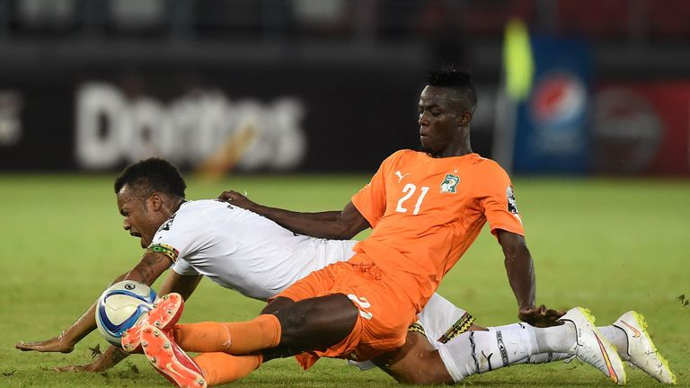 Ivory Coast's defender Eric Bailly challenges Ghana's forward Jordan Ayew (back) during the 2015 African Cup of Nations final in February 2015