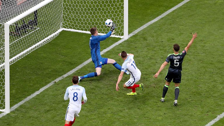 England's Jamie Vardy scoring his side's first goal against Wales