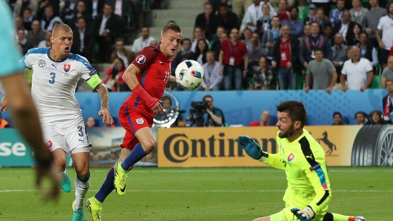 Matus Kozacik of Slovakia saves a shot from England's Jamie Vardy of England during Group B clash